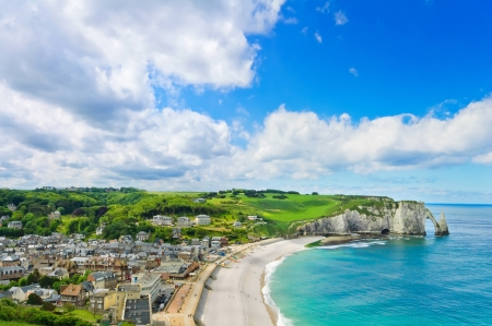 Etretat village, its bay beach and Aval cliff landmark Aerial view Normandy, France, Europe