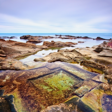 Le Vaschette water pool and rocks, coastal seascape near Livorno Long exposure photography, Italy   Stock Photo - 14960771