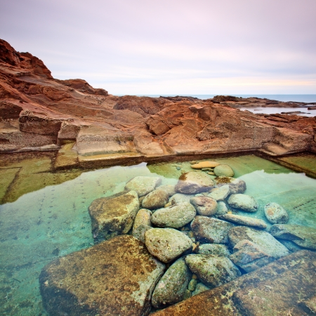 Le Vaschette water pool and stones coastal landscape near Livorno. Long exposure photography, Italy, Europe. Stock Photo - 14960773