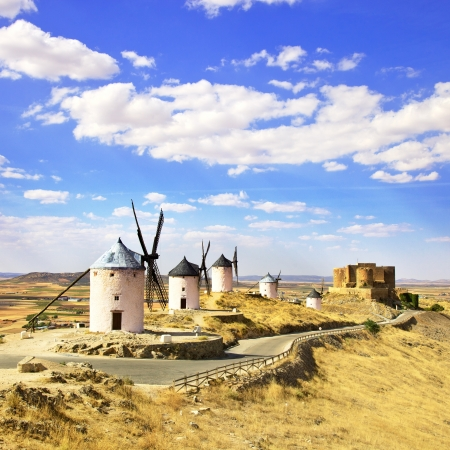 spanish culture: Cervantes Don Quixote windmills and Consuegra castle  Castile La Mancha, Spain, Europe Editorial