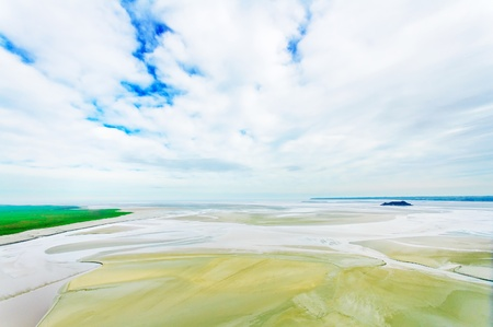 Low tide landscape in Mont Saint Michel Bay landmark  Normandy, France, Europe photo