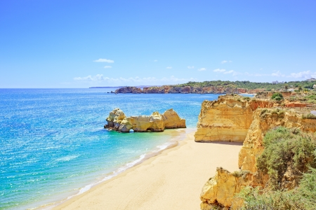 Beach and rock formation known as Praia da Rocha in travel destination Portimao Algarve, Portugal, Europe