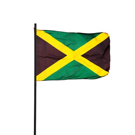 Jamaica flag in the wind and its black pole isolated on white background  Real photography photo