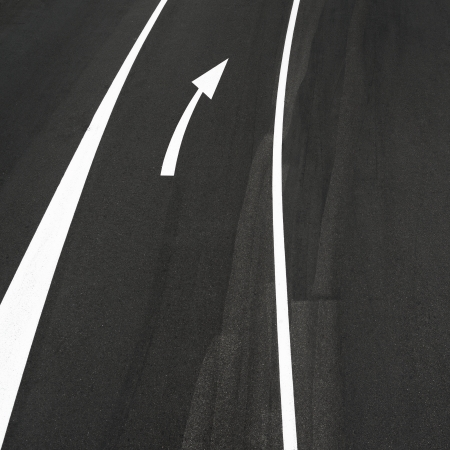 Road asphalt abstract, two white lines and right arrow sign photo