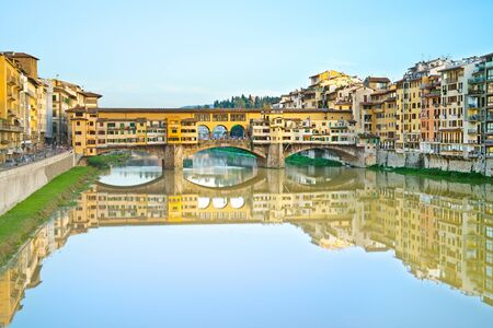 Ponte Vecchio, old bridge, medieval landmark on Arno river and its reflection  Long exposure photography  Florence, Tuscany, Italy  photo