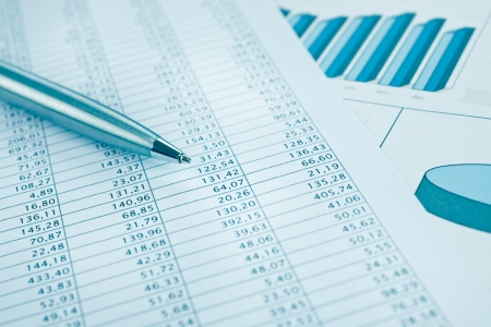 Business data report close up  Montly stock stats  Ink color print paper and pen  Blue toned  Stock Photo - 16142734