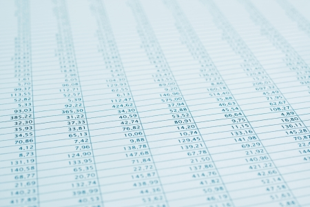stock listing: Business data report selective focus close up  Monthly stock stats spreadsheet  Blue toned