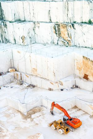 carrara: White marble quarry with excavators  Carrara, Tuscany, Italy