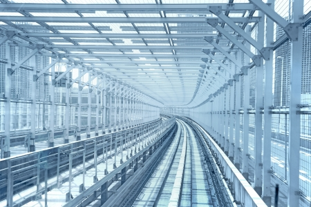 hereafter: Tokyo monorail transportation system line in metal tunnel cage  Blue toned