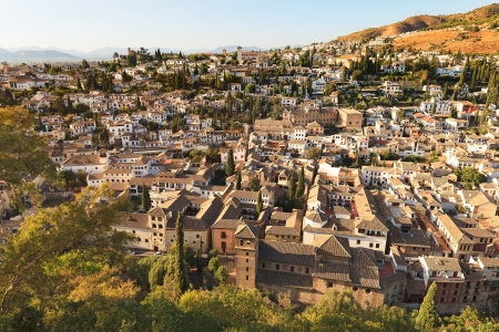 Granada, aerial panoramic view of old Albaicin district from Alhambra on sunset  Andalusia, Spain, Europe  photo