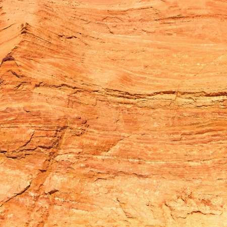 roussillon: Red rock background, texture, pattern, wallpaper from Les Ocres du Roussillon, Luberon Natural Regional Park, Provence Cote Azur, France  Stock Photo