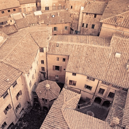 Aerial view background on italian medieval architecture roofs city building  Tuscany, Italy  Sepia toned    photo