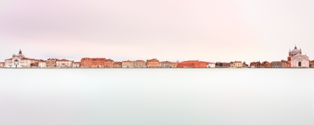 Famous Giudecca Canal landmark in Venice in a panoramic long exposure photography  Giudecca Canal is the largest water canal in Venice  On the left Zitelle Church, on the right Redentore Church  Italy, Europe Stock Photo - 16555742