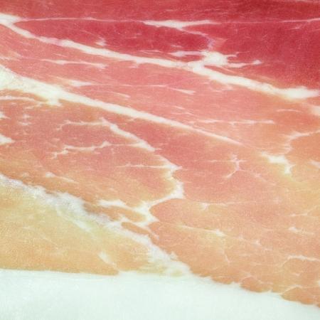 emilia romagna: Italian pork ham Prosciutto or cold cut background texture close up  Prosciutto ham is a staple food product of Italy