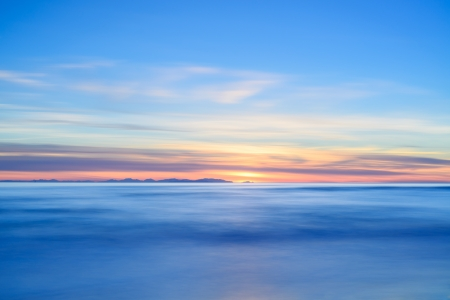 capraia: Corsica or Corse and Capraia islands view from Italian beach coast on twilight sunset time  Mediterranean sea, Tuscany, Italy, Europe  Long Exposure Photography
