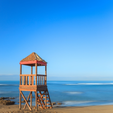 lifeguard tower: Lifeguard or baywatch wooden beach observation tower, cabin or hut  Long exposure photography  Italy