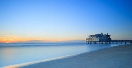 Pier and building on sea water and beach  Panoramic long exposure photography in Follonica travel destination, Maremma, Tuscany, Italy, Europe Stock Photo - 17145985