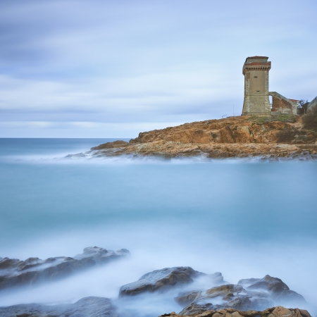 Calafuria Tower landmark on cliff rock and sea in winter  Tuscany, Italy, Europe photo
