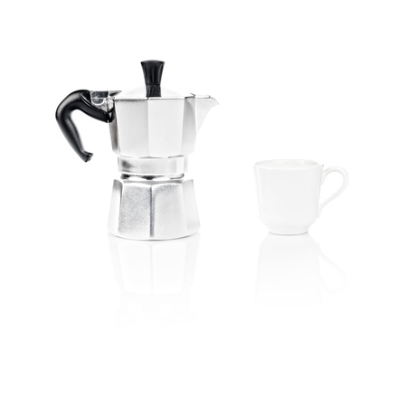 Moka Pot, also known as stove top espresso machine italian coffee maker and a coffee cup on white background and reflection photo