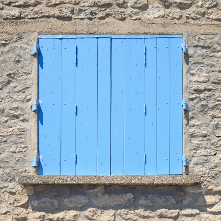 Close up of a traditional old blue painted wooden door in Provence, France, Europe  Pattern, texture, background Stock Photo - 17676799