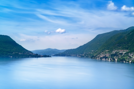 long lake: Como Lake landscape  Cernobbio village, trees, water and mountains  Italy, Europe  Stock Photo