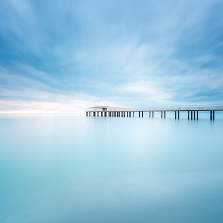 Modern steel pier in a cold atmosphere Long exposure photography in Lido Camaiore, Versilia, Tuscany, Italy, Europe