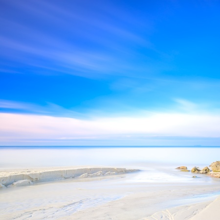 White sand dunes beach, rocks, blue ocean and sky on background Stock Photo - 17811075