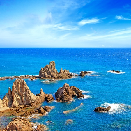 Cliff Rocks and Ocean near Carboneras coastal landscape Cabo de Gata Nijar Park, Andalusia largest protected area