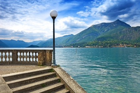 bellagio: Como Lake landscape  Street Lamp post, stairs, mountains and water  Bellagio Italy Stock Photo
