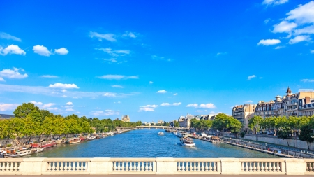 balcony view: Paris, Seine river and traditional boats  Aerial view from a bridge balcony  France, Europe