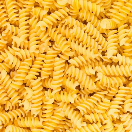 fusilli: Italian Fusilli or Rotini helix shaped Macaroni Pasta raw food background or texture close up