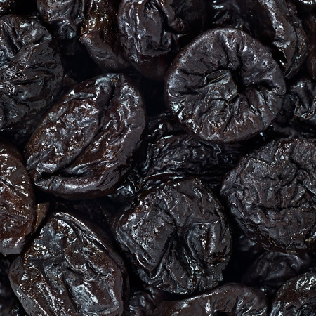 Dried plums or prunes fruit background texture pattern wallpaper photo