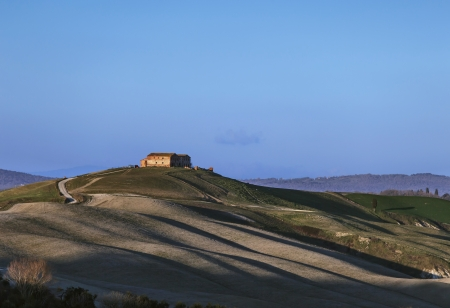 Tuscany, Crete Senesi old farmland and rolling hills on sunset  Rural landscape, Italy, Europe  photo
