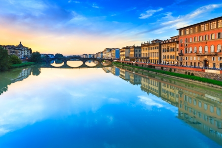 Florence, Ponte alla Carraia medieval Bridge landmark on Arno river, sunset landscape with reflection  It is the second oldest bridge, built in 1218, in the city  Tuscany, Italy  photo