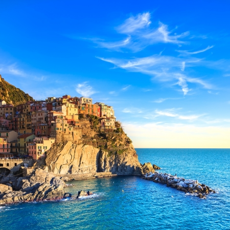 crepuscle: Manarola village on cliff rocks and sea at sunset , Seascape in Five lands, Cinque Terre National Park, Liguria Italy Europe  Square format  Stock Photo