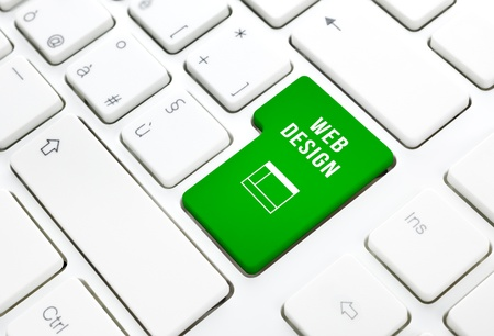 Web Design business concept, green enter button or key on white keyboard photography  Stock Photo - 18534853