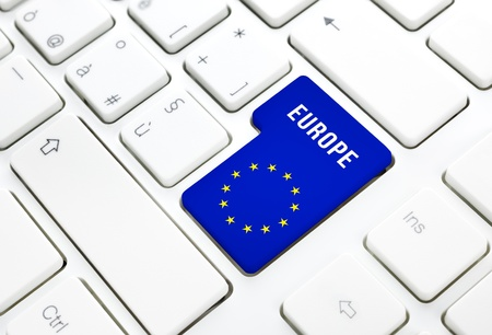 Europe web concept, blue and star flag enter button or key on white keyboard photography