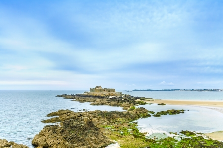 Saint Malo beach, Fort National and rocks during Low Tide  Brittany, France, Europe  photo