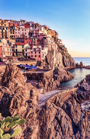 cinque: Manarola village on cliff rocks and sea at sunset , Seascape in Five lands, Cinque Terre National Park, Liguria Italy Europe