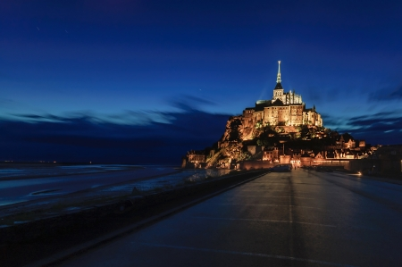 Mont Saint Michel monastery and bay landmark night view   heritage site  Normandy, France, Europe  photo