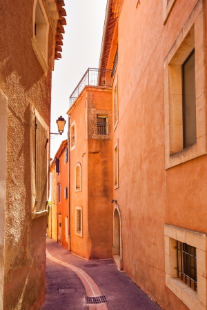 the luberon: Roussillon village, urban street and red facades  Luberon Natural Regional Park, Provence, France