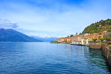 Bellagio town in Como lake district  Landscape with marina and italian traditional lake village  On background Alps mountains covered by snow  Lombardy region, Italy, Europe  Stockfoto