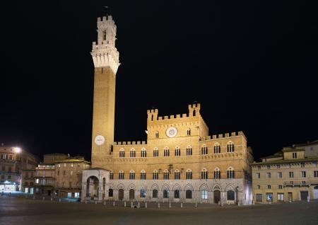 siena: Siena landmark night photo  Piazza del Campo square, Torre del Mangia tower and Palazzo Pubblico building  Tuscany, Italy Stock Photo
