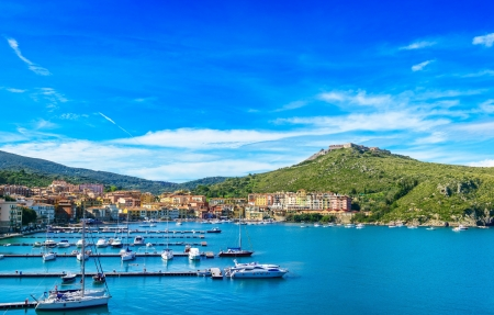 Porto Ercole village and boatd in harbor in a sea bay  Filippo fort on background  Aerial view  Monte Argentario, Tuscany, Italy Imagens