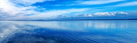 Sunset blue panoramic landscape  Orbetello lagoon with reflection, Argentario, Tuscany, Italy  photo