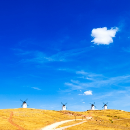 don: Cervantes Don Quixote windmills, rural green fields, blue sky and small cloud in Consuegra  Castile La Mancha, Spain, Europe