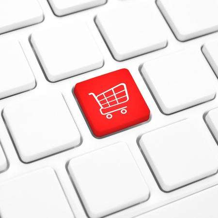 Shop online business concept, Red shopping cart button or key on white keyboard photo