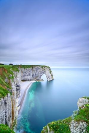 monet: Etretat, la Manneporte natural rock arch wonder, cliff and beach  Long exposure photography  Normandy, France  Stock Photo