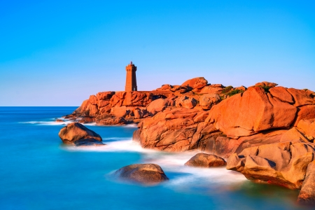 ploumanach: Ploumanach Mean Ruz lighthouse red sunset in pink granite coast, Perros Guirec, Brittany, France  Long exposure