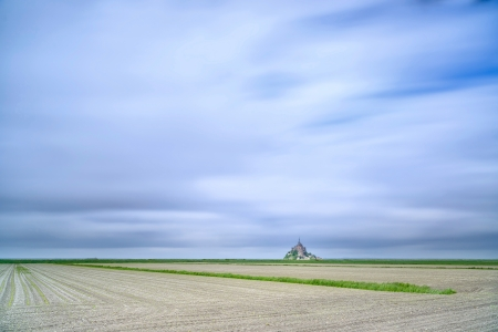 Mont Saint Michel monastery landmark and field  Unesco heritage site  Normandy, France, Europe  Long exposure photography photo